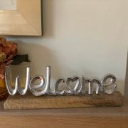 Silver Coloured Welcome Sign on a Wooden Base